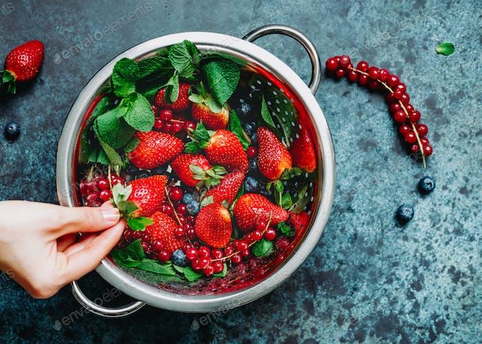 Metal colander with fresh berries