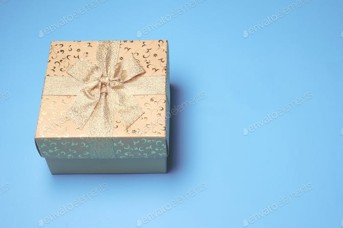 Top view of gift box on blue background. Free space for text