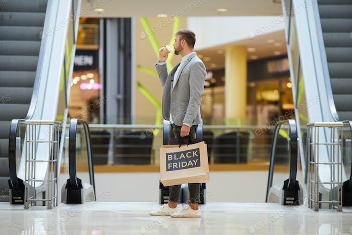 Stylish Man Shopping in Mall