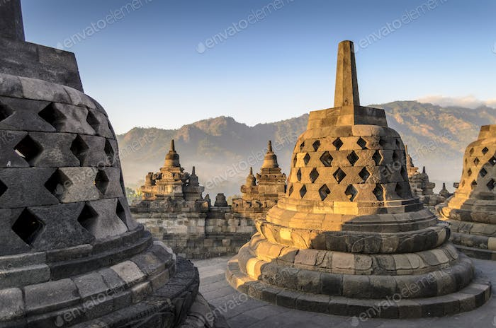 Borobudur temple, a 9th century Buddhist temple with terraces and stupa with latticed exterior, bell