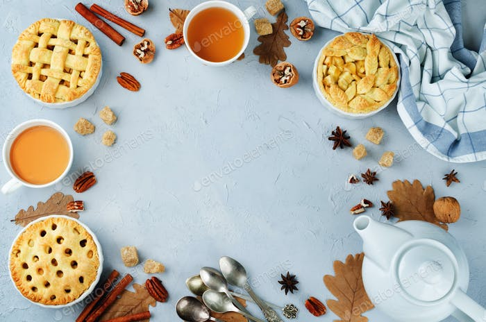 Wood background with apple pies, tea and nuts. tonung. selective