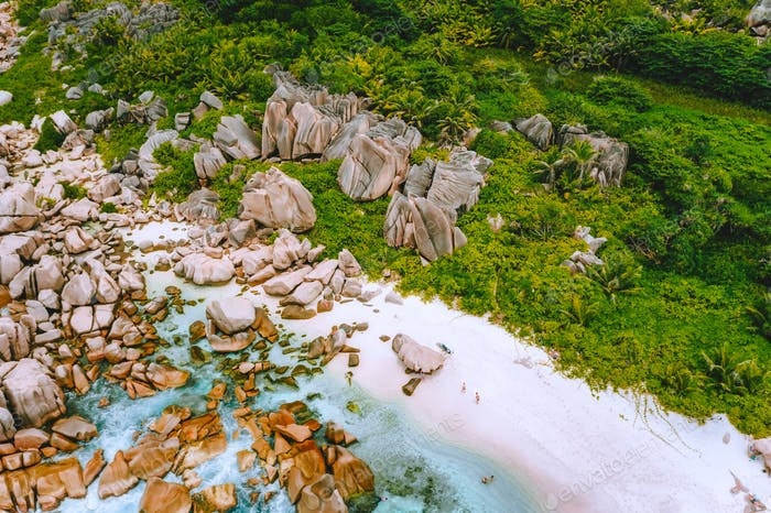 La Digue, Seychelles. Aerial view of secluded beach hidden in the jungle. White sand beach with