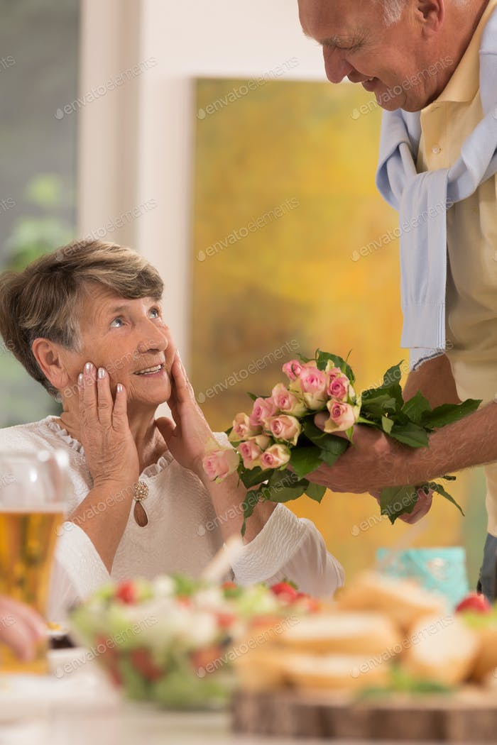 Bouquet of roses to surprised wife