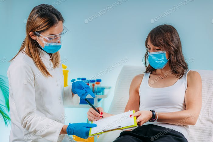 Nurse with Protective Mask Filling in Information Form. Blood Drawing and Analysis