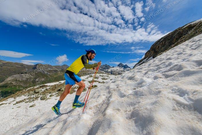 Skyrunner runner uphill in a snowy