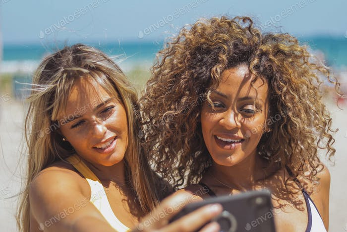 Excited sportswomen taking selfie in sunshine