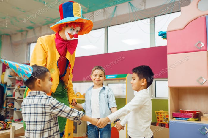 Clown with cheerful children play counting game