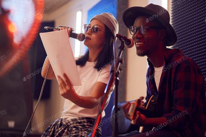 Musical Duo Singing in Studio