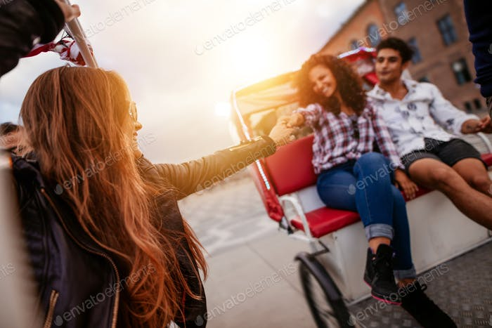 Young people enjoying tricycle ride