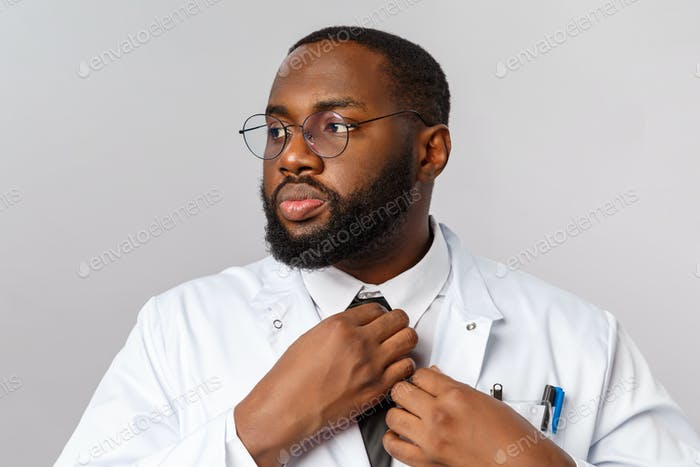 Young African-American Doctor on Grey