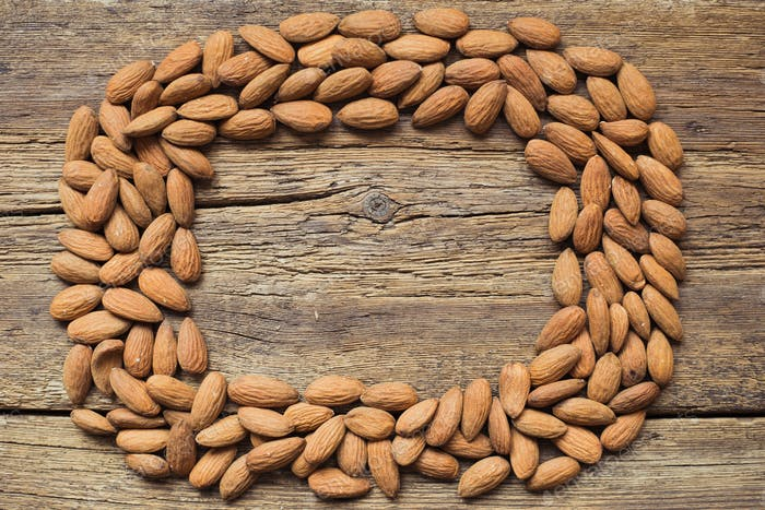 Almonds on wooden background