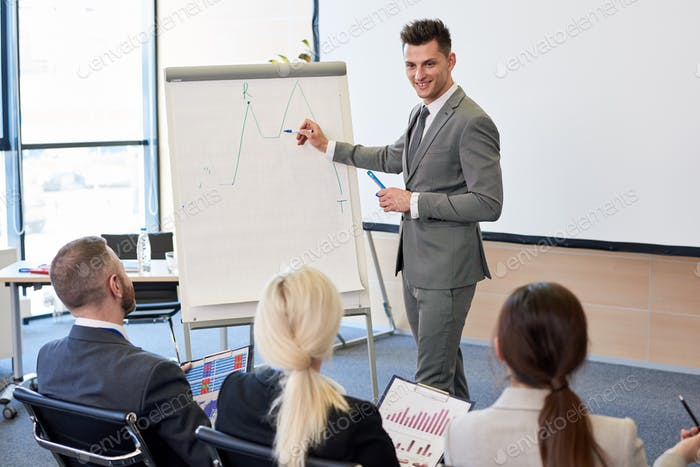 Business Coach Pointing at Graph