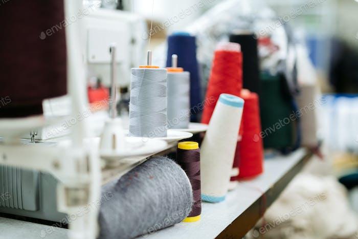Wool and thread spools on desk
