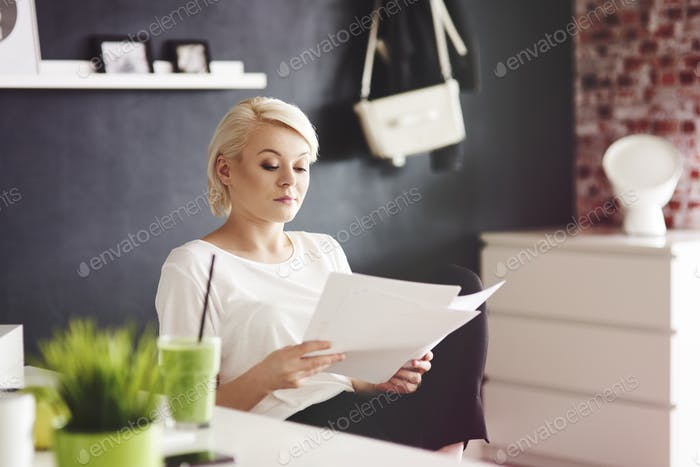 Serious woman browsing financial documents