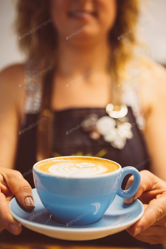 Female hands with coffee cup of latte