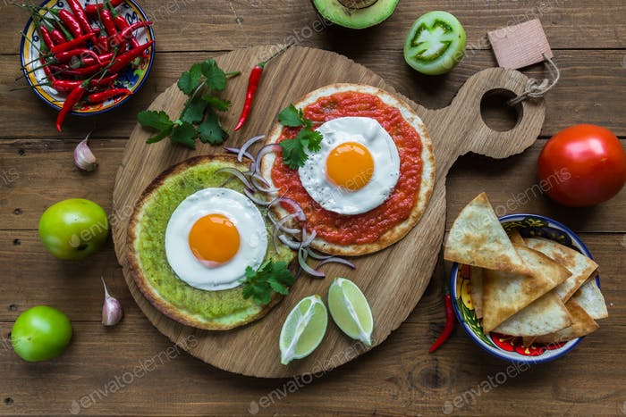 huevos divorciados, fried eggs on corn tortillas with salsa verde and  roja, mexican breakfast