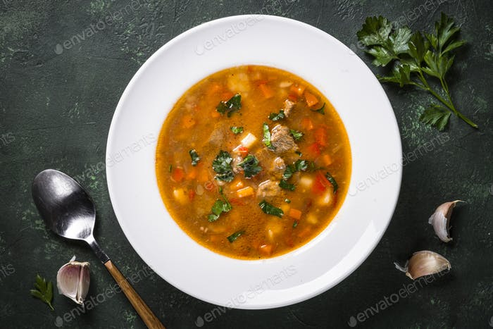 Traditional Hungarian goulash soup on the table