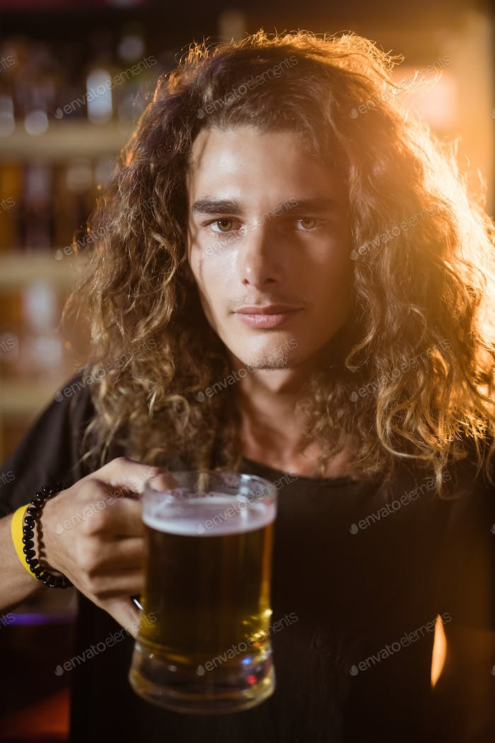 Portrait of young man holding drink