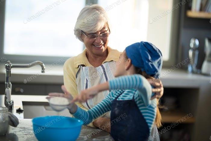 Grandmother praising granddaughter