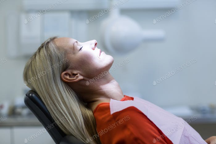 Woman relaxing on dentist chair