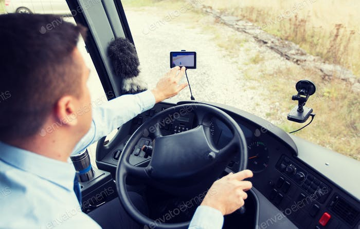 close up of bus driver driving with gps navigator