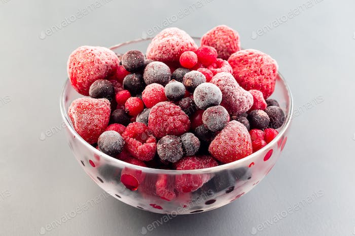 Frozen berries in bowl, raspberry, strawberry, cranberry and black currant