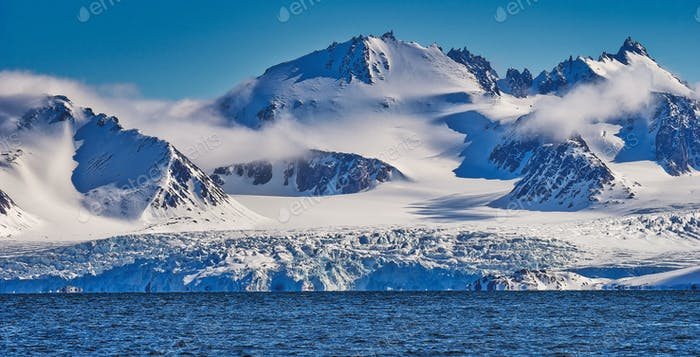Deep Blue Glacier and Snowcapped Mountains, Arctic, Svalbard, Norway