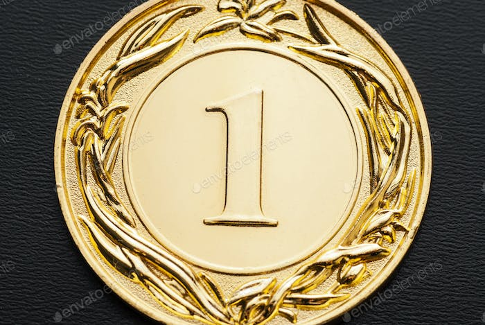 Close-up of a golden medal for the number one