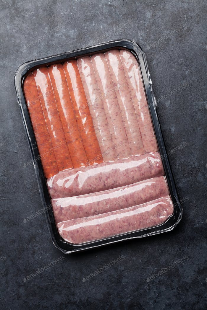 Raw sausages in tray