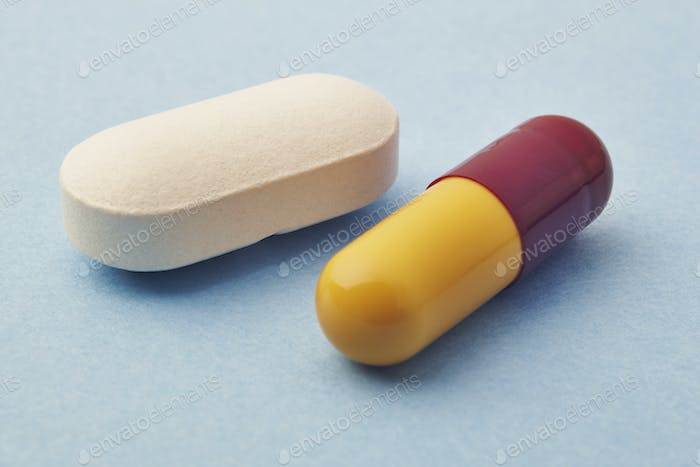 Pills over a blue background. Medicament treatment. Health care photo