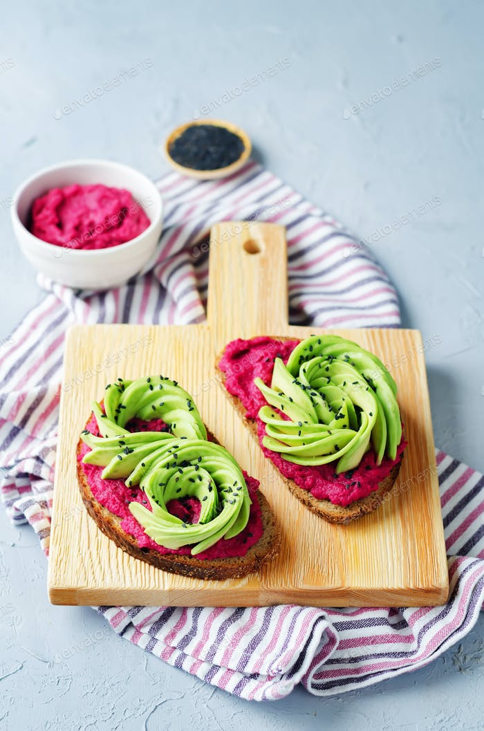 Healthy beet hummus avocado rye breakfast sandwiches