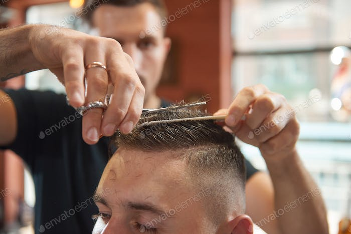 Young man at the barbershop