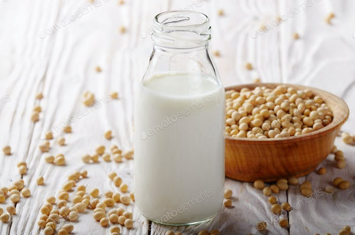 Non-dairy alternative Soy milk or yogurt in glass bottle on whit
