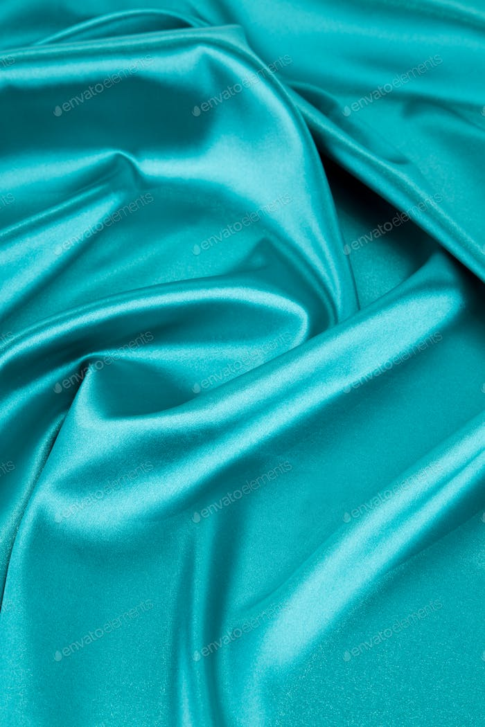 Blue silk cloth texture close up.