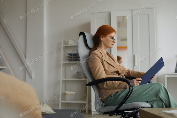 Businesswoman with document at office