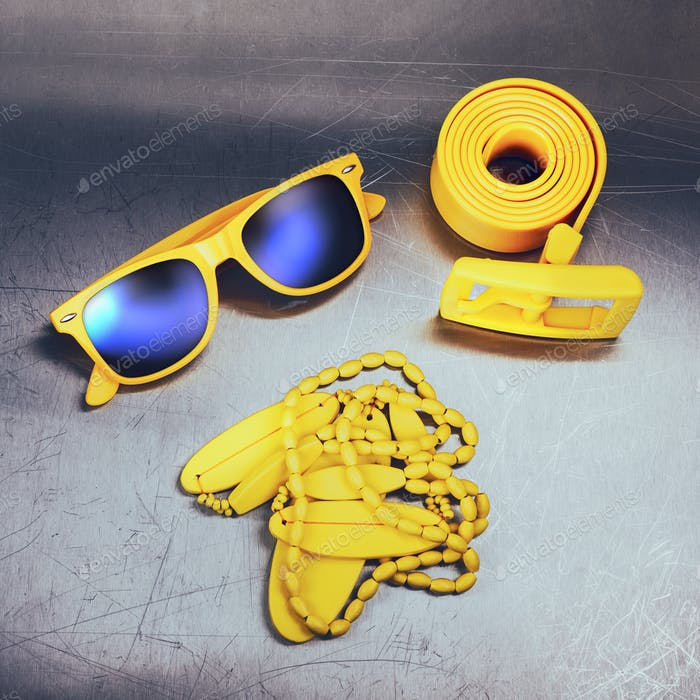 Bright yellow accessories on metal background