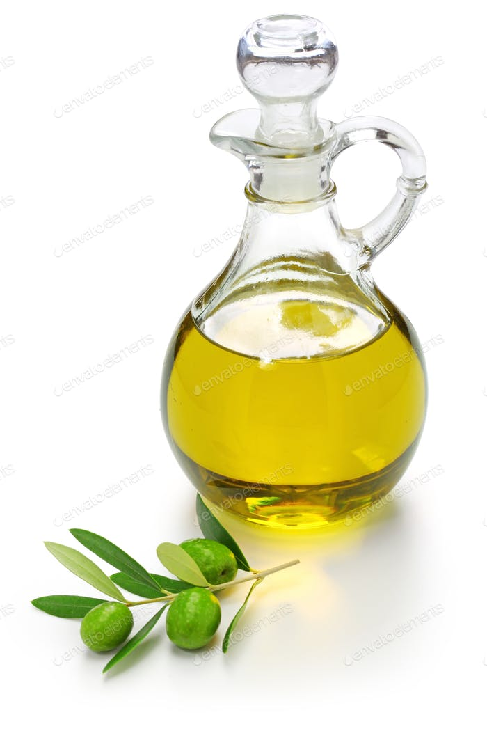 extra virgin olive oil with green olives and leaves isolated on white background