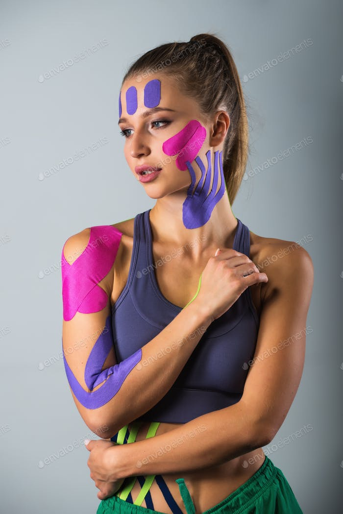Portrait of sports woman. kinesio therapeutic tape glued to the body