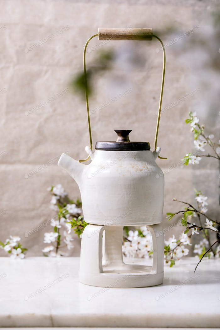 White and black handmade ceramic teapot for tea ceremony
