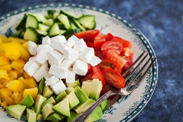 Delicious tomato, bell pepper, cucumber, avocado, onion and feta