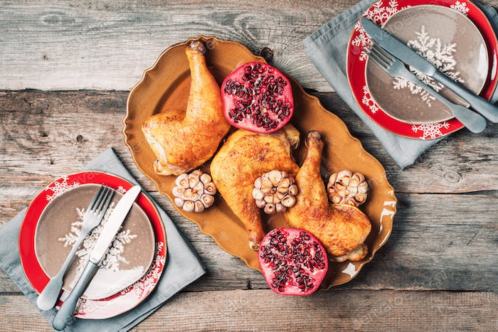 Traditional Thanksgiving day celebration party. Roasted chicken with pomegranate and garlic on