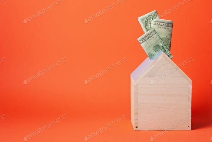 Money box full of dollars