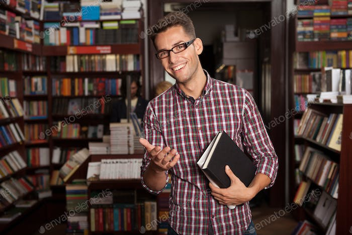 young caucasian guy in bookstore