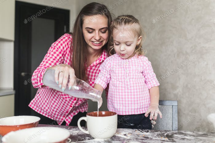 Mom and daughter together in the kitchen