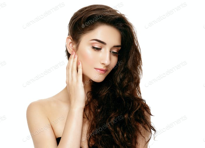 Beautiful woman face portrait with curly flying hair studio on white