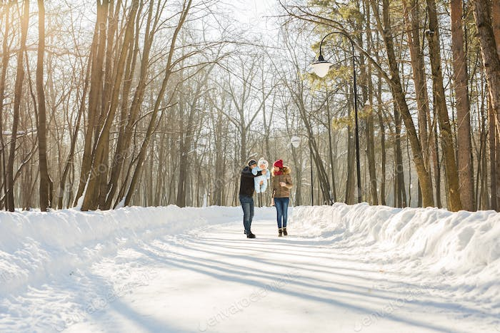 family outdoors in winter landscape