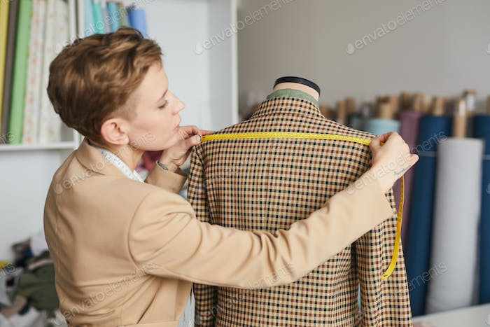 Tailor measuring the jacket