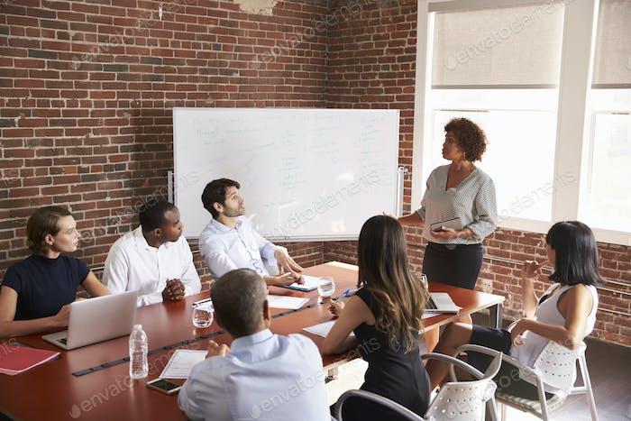 Mature Businesswoman Addressing Boardroom Meeting