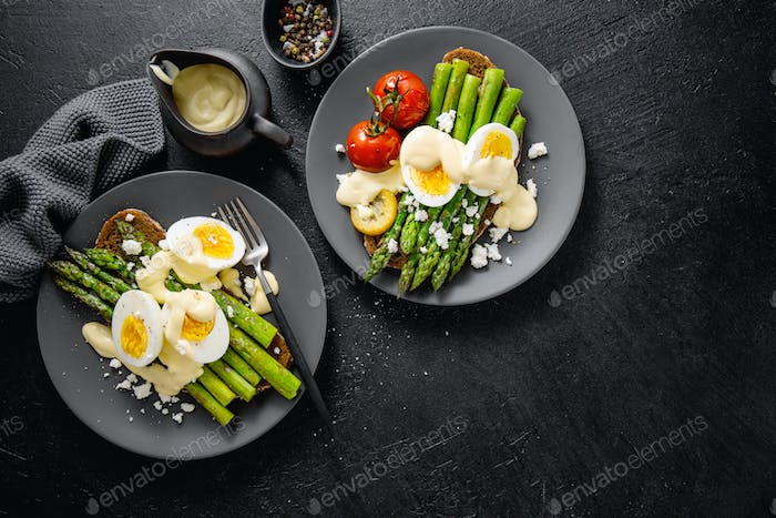 Tasty toasts with asparagus, eggs and sauce