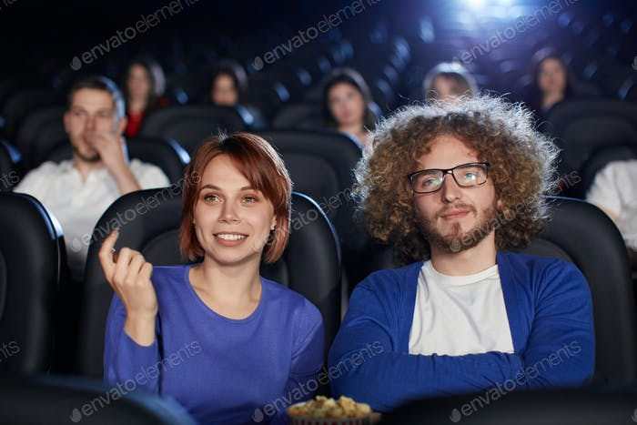 Couple enjoying date in movie theater